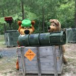 yogi bear™ and boo boo playing laser tag